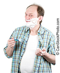 Senior man with a shaving foam