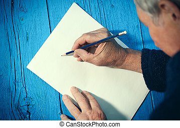 Senior man with blank white paper sheet and pencil - Top ...