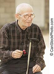 Senior man with cherry