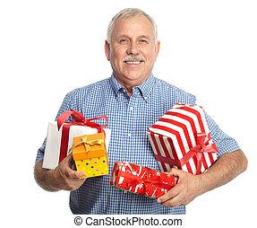 Senior man with Christmas gifts.