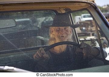 Senior Man With Cowboy Hat Driving Pickup