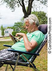 Senior man with digital tablet