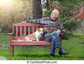 Senior man with dogs and cat