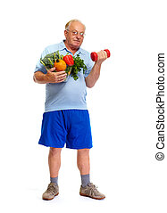 Senior man with dumbbell and vegetables.