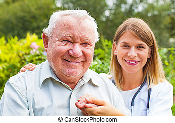 Senior man with female doctor