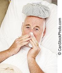 Senior Man with Flu - Senior man home sick with the flu.