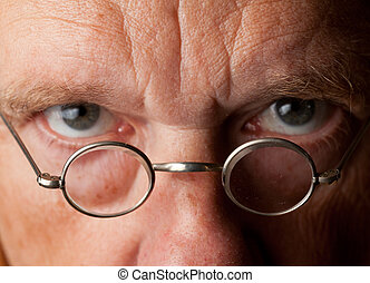Senior man with focus on glasses