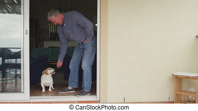 Senior man with his dog at home