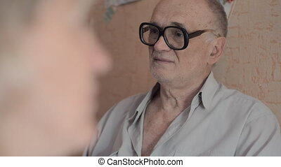 Senior man with his family at home - Senior man in glasses...