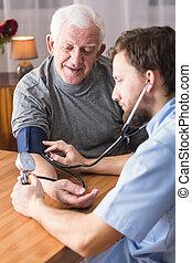 Senior man with hypertension