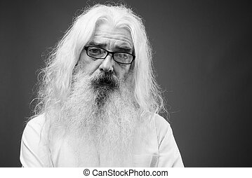 Senior man with long hair and beard in black and white