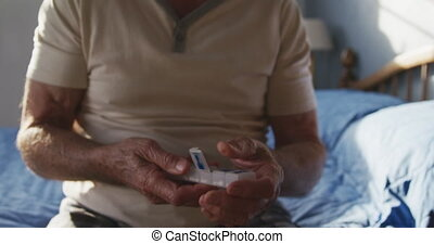 Senior man with medical drugs at home - Front view mid...
