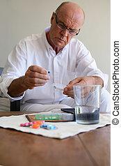Senior man with medication