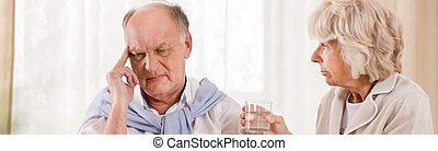 Senior man with migraine