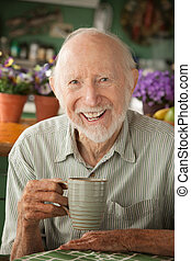 Senior man with mug