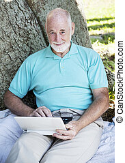 Senior Man with Netbook