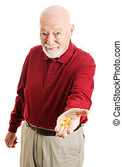 Senior Man with Omega 3 Fish Oil - Senior man holding out a ...