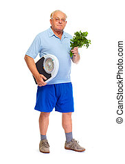 Senior man with scales and vegetables.