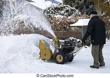 senior man with snowblower - senior man with snow blower in...
