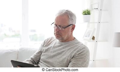 senior man with tablet pc at home 6 - technology, people and...