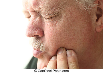 Senior man with tooth pain