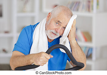 senior man with towel in gym