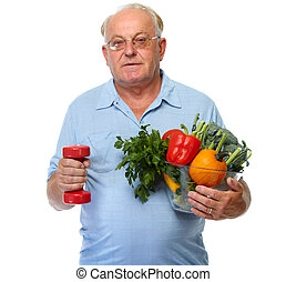 Senior man with vegetables and dumbbell.