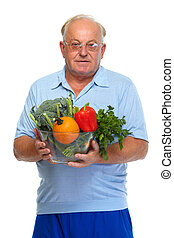 Senior man with vegetables.