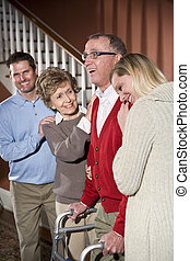 Senior man with walker at home with family - Happy senior ...