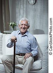 Senior man with walking stick