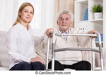 Senior man with walking zimmer - Image of senior man with...