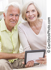 Senior Man & Woman Couple Using Tablet Computer