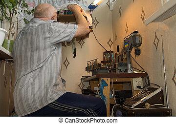 Senior man working at a workbench
