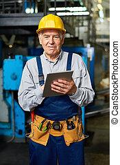 Senior Man Working at Modern Factory