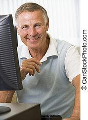Senior man working on a computer