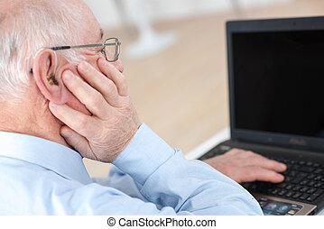 senior man working on computer