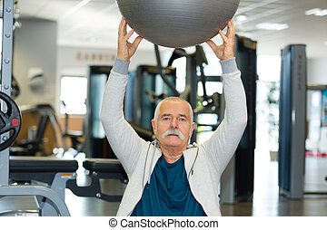 senior man working out at the gym