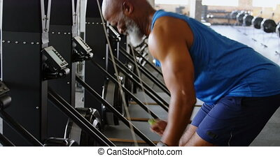 Senior man working out in the fitness studio 4k