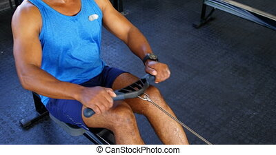 Senior man working out on rowing machine 4k - Senior man...