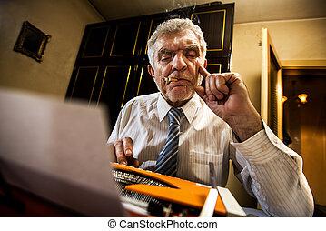 Senior man writing on a typewriter - Retro Senior man,...
