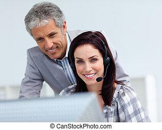 Senior manager checking his employee\'s work