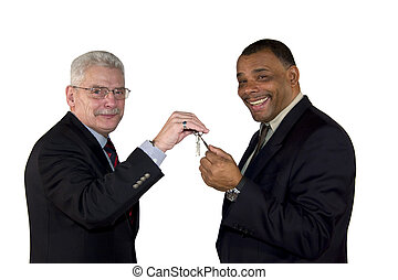 senior manager handing over a key to his partner - a ...