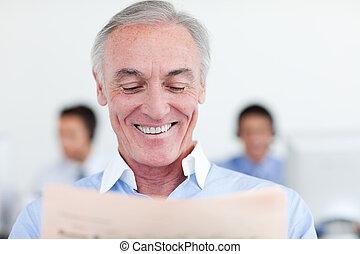 Senior manager reading at his desk