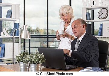 Senior manager with a laptop