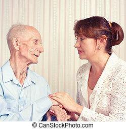 senior mand, kvinde, hos, deres, caregiver, hos, home.