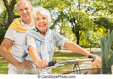 Senior marriage cycling together