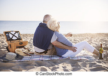 Senior marriage having good morning on the beach