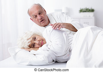 Senior marriage in bed