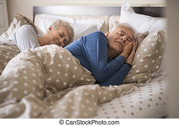 Senior marriage in the comfortable bed
