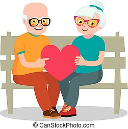 Senior married couple sits on a bench holding a heart symbol